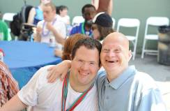 Smiling adults with disabilities